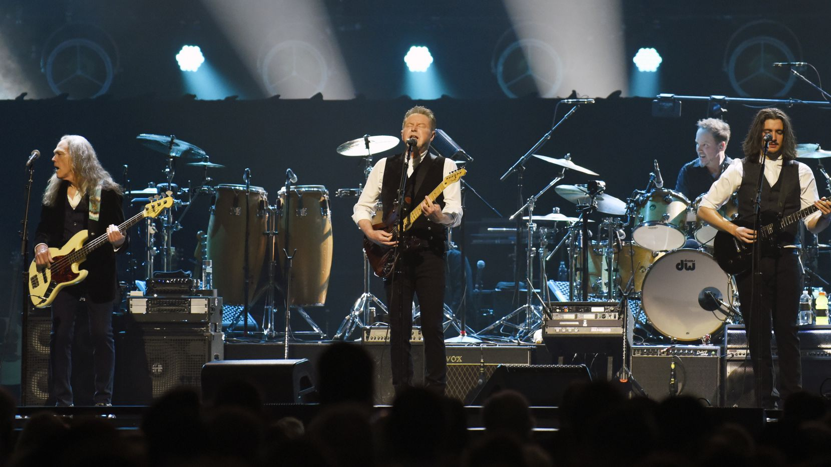 Don Henley (center) performed with other members of the Eagles at the American Airlines Center in Dallas on Feb. 29, shortly before the pandemic intensified.
