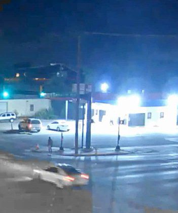 Surveillance footage shows the silver two-door car that hit and seriously injured a person at the intersection of Riverside Drive and Lancaster Avenue in Fort Worth.