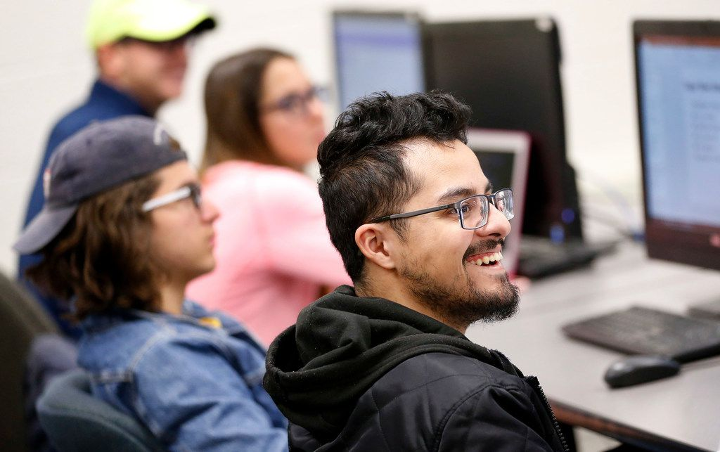 Student Robert Gallegos reacts to Super Bowl ad Thursday in the Integrated Marketing Communications and Advertising class at the University of Texas at Arlington.