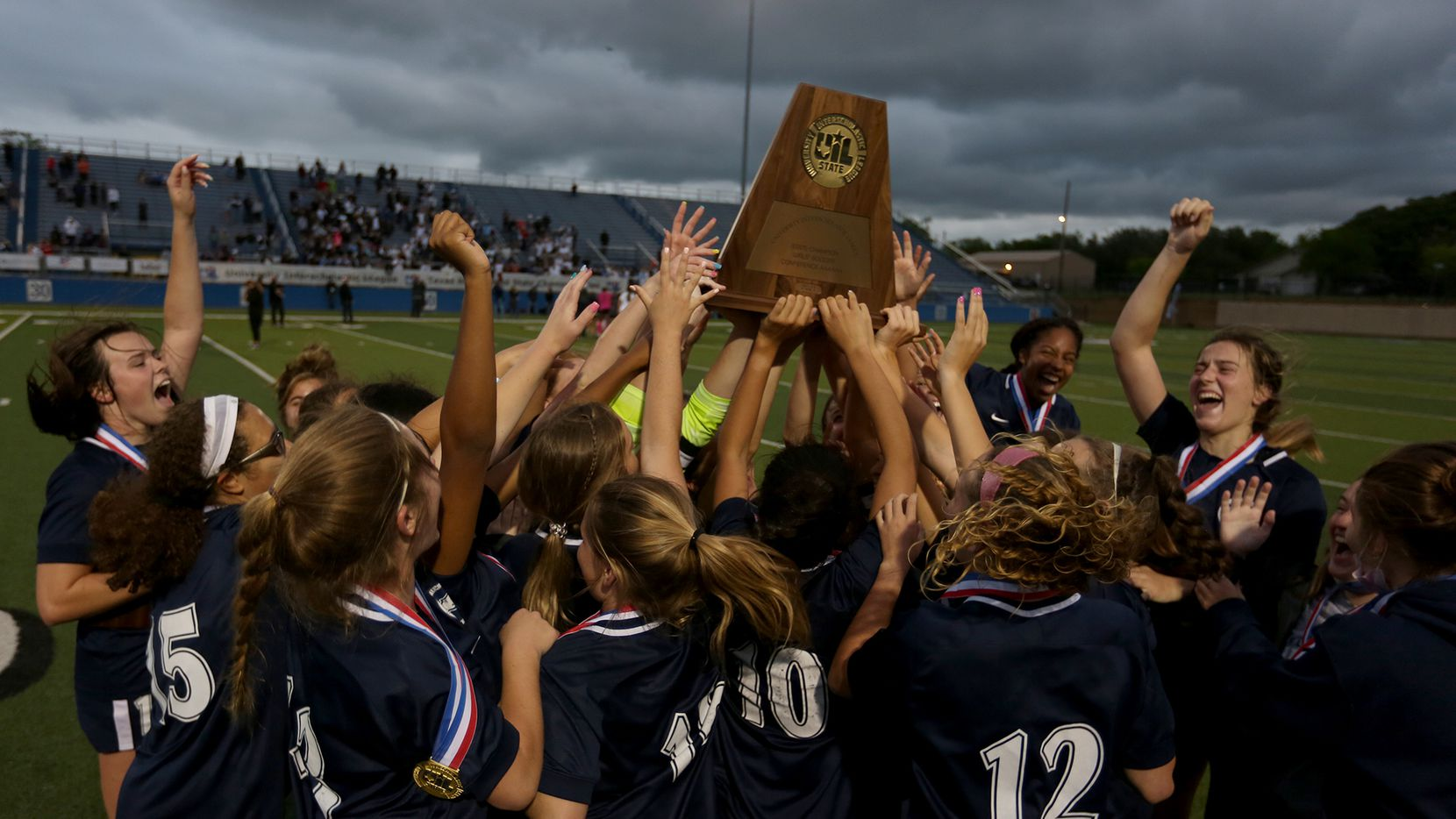 Lewisville Flower Mound players celebrate with the trophy after their UIL 6A girls State championship soccer game against Austin Vandegrift at Birkelbach Field on April 16, 2021 in Georgetown, Texas. Lewisville Flower Mound won 2-1.