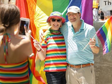 """Emily Bahr, left, takes picture of Mary Bahr and Mark Bahr during the North Texas Pride """"Come As You Are"""" Festival at Haggard Memorial Park in Plano, TX, on May 9, 2018. This year's event will take place in downtown Plano on Saturday, Sept. 25 along with the Downtown Plano Art & Wine Walk."""