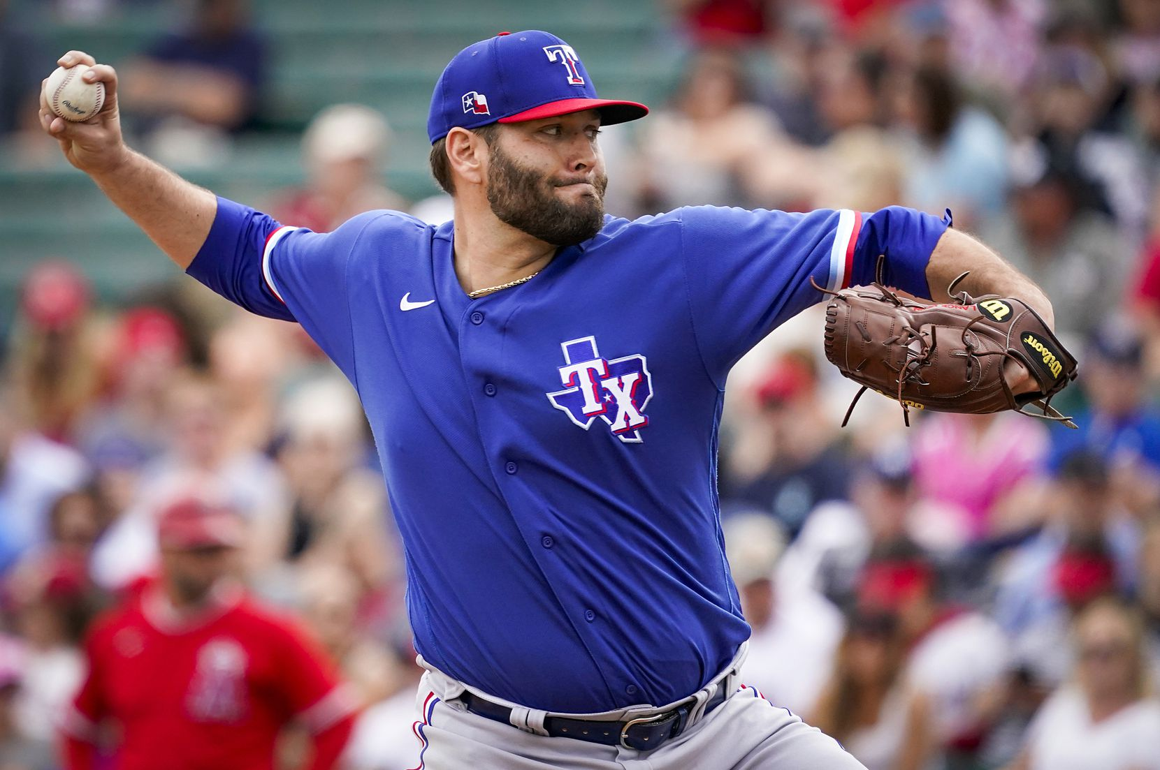 Texas Rangers pitcher Lance Lynn pitches during the first inning of a spring training game against the Los Angeles Angels at Tempe Diablo Stadium on Friday, Feb. 28, 2020, in Tempe, Ariz.