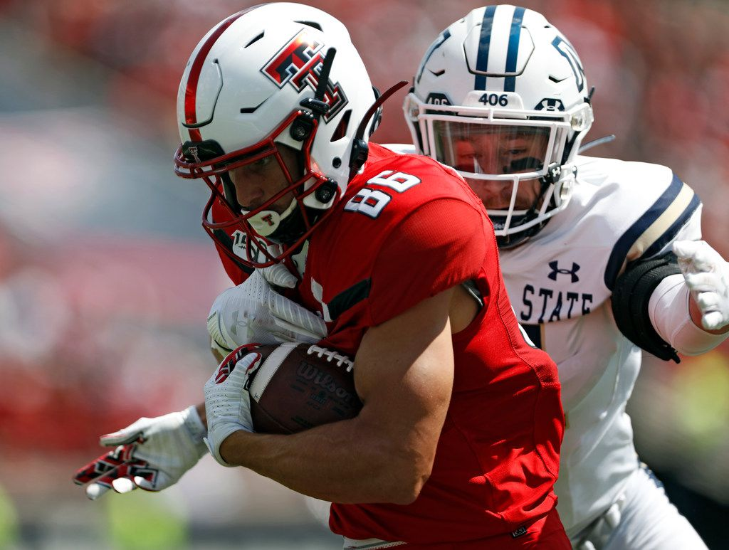 Texas Tech's Dalton Rigdon (86) runs with the ball as he is tackled by Montana State's Sal Aguilar (46) during the first half of an NCAA college football game, Saturday, Aug. 31, 2019, in Lubbock, Texas. (Brad Tollefson/Lubbock Avalanche-Journal via AP)