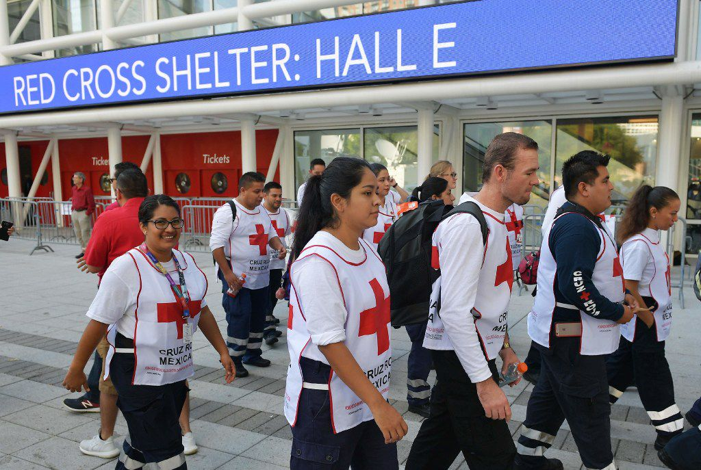 Red Cross workers from Mexico arrive at the George R. Brown Convention Center which has been a shelter for evacuees from Hurricane Harvey, in Houston on September 2.