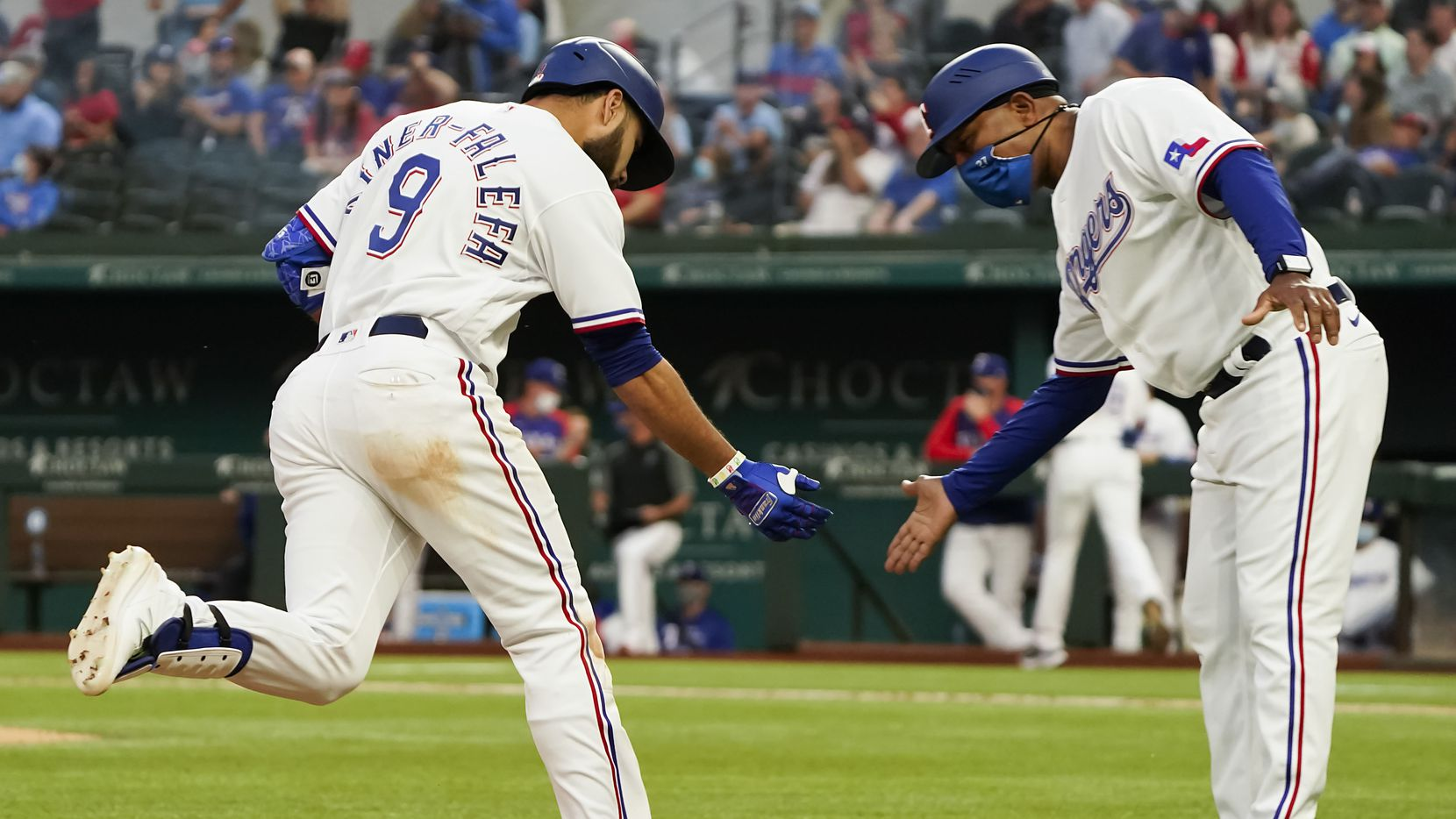 Texas Rangers shortstop Isiah Kiner-Falefa celebrates with third base coach Tony Beasley after hitting a solo home run during the fifth inning against the San Diego Padres at Globe Life Field on Saturday, April 10, 2021. (Smiley N. Pool/The Dallas Morning News)