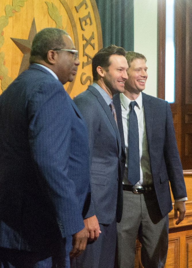 Sen. Royce West, D-Dallas, and Rep. Matt Krause, R-Fort Worth, pose for a photo with former Dallas Cowboys quarterback Tony Romo at the Texas Capitol in Austin, Wednesday, May 3, 2017.