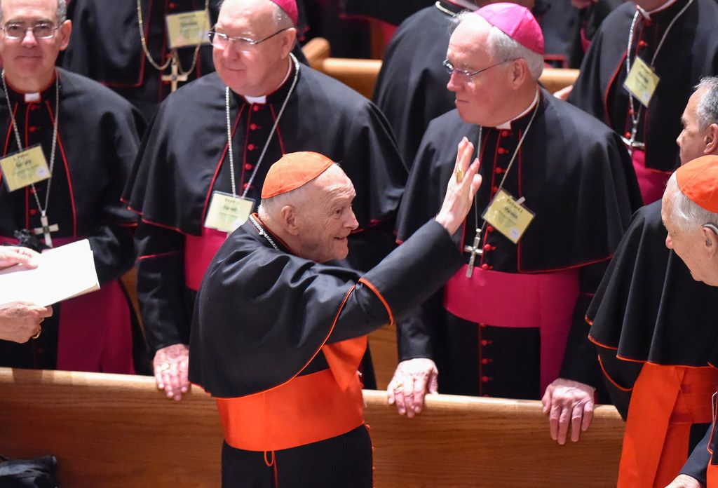 Cardinal Theodore McCarrick waves to fellow bishops at the Cathedral of St. Matthew the Apostle in Washington in September 2015, during Pope Francis's visit.