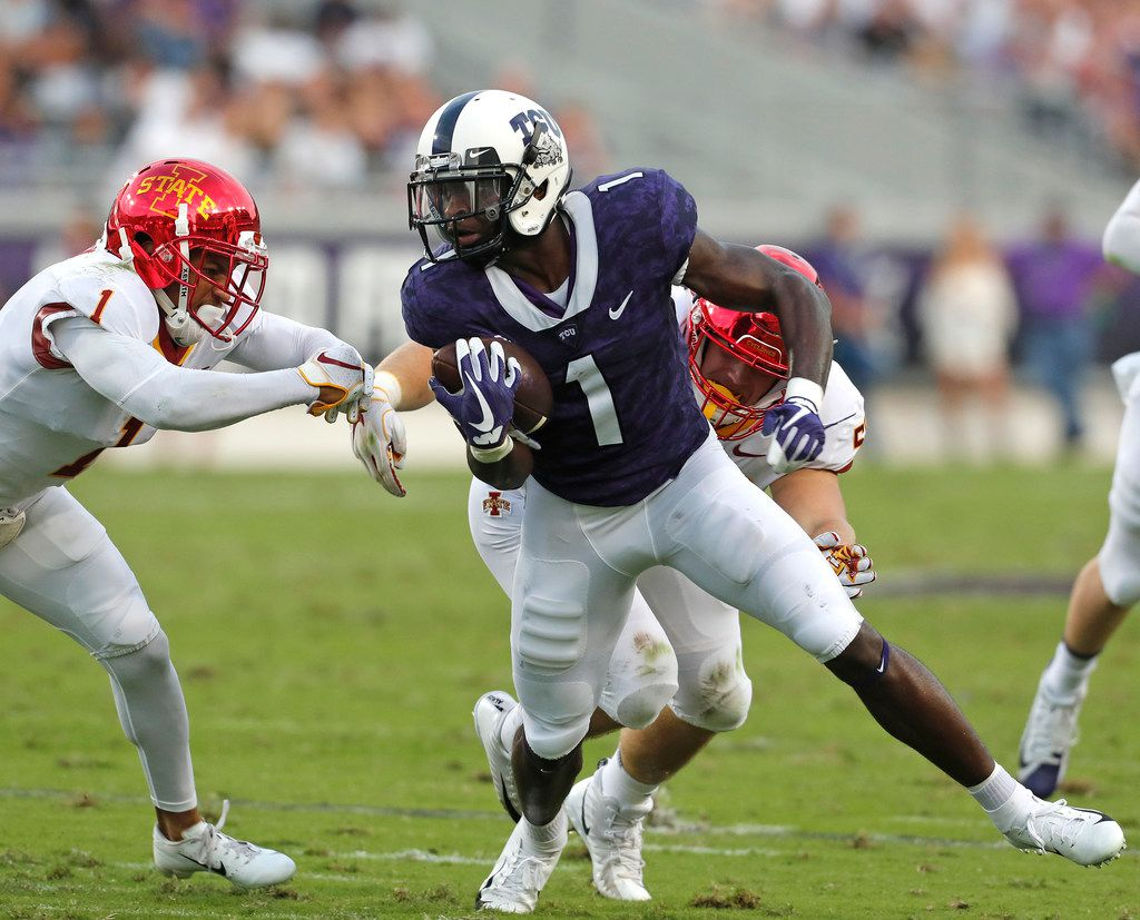 TCU wide receiver Jalen Reagor (1) is brought down by Iowa State defensive back D'Andre Payne (1) in the first half of a NCAA college football game at Amon G. Carter Stadium Saturday September 29, 2018. (Bob Booth/Special Contributor)