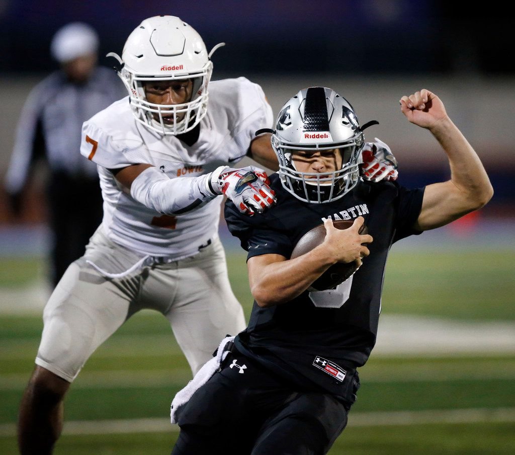 On a fourth down play, Martin High quarterback Zach Mundell (6) picks up the first down as he's tackled by Bowie DeAnte Betts (7) during the first half at Maverick Stadium in Arlington, Texas, Thursday, November 7, 2019. (Tom Fox/The Dallas Morning News)