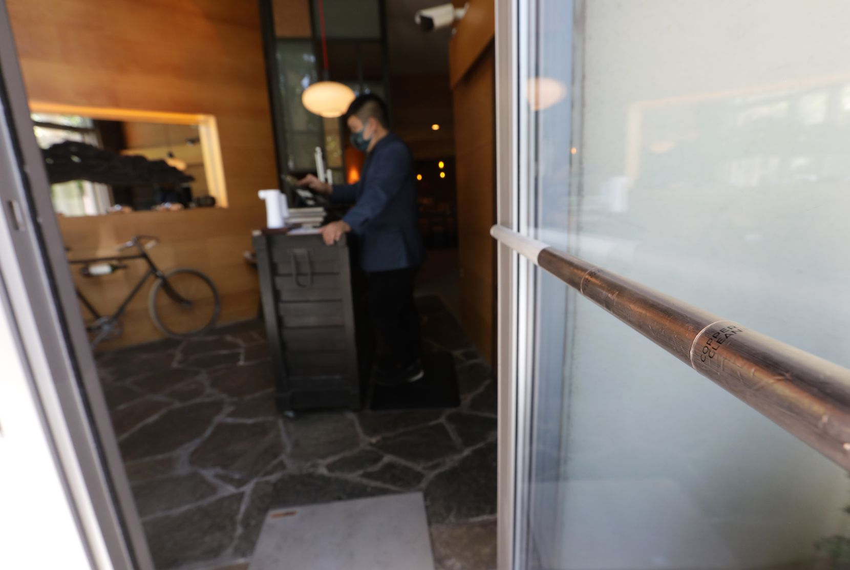 The Copper Clean brand door handle cover at Tei An restaurant in Dallas