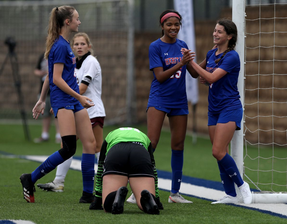Midlothian Heritage players celebrate as they make another goal against Calallen during their UIL 4A girls State championship soccer game at Birkelbach Field on April 16, 2021 in Georgetown, Texas.  (Thao Nguyen/Special Contributor)