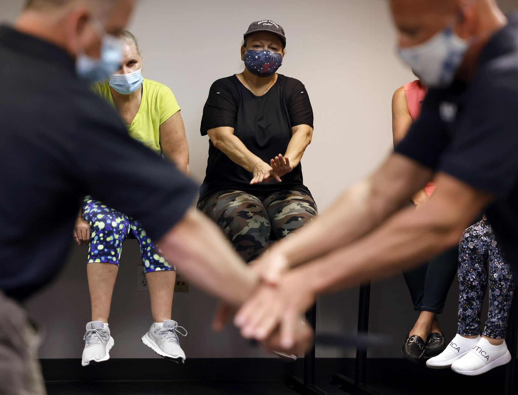 Ameristar Jet Charter flight attendant Lucy Waldenstrom follows along as federal air marshals demonstrate a maneuver during a self-defense training session at the Transportation Security Administration offices in Coppell.