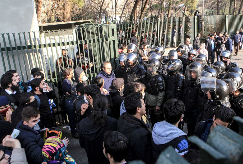In this Dec. 30, 2017 file photo taken by an individual not employed by the Associated Press and obtained by the AP outside Iran, anti-riot Iranian police prevent university students to join other protesters over Iran weak economy, in Tehran, Iran. New unrest in Iran over the past 10 days appears to be waning, but anger over the economy persists. The protests in dozens of towns and cities also showed that a sector of the public was willing to openly call for the removal of Iran's system of rule by clerics -- frustrated not just by the economy but also by concern over Iran's foreign wars and general direction. (AP Photo, File)