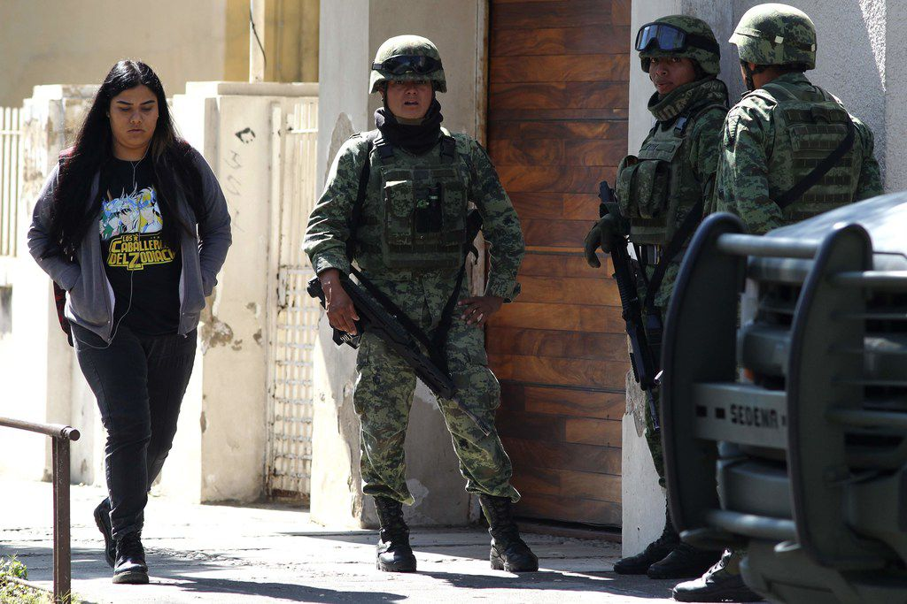 Members of the Mexican Army stand guard outside the U.S. Consulate in Guadalajara, Mexico on December 01, 2018.