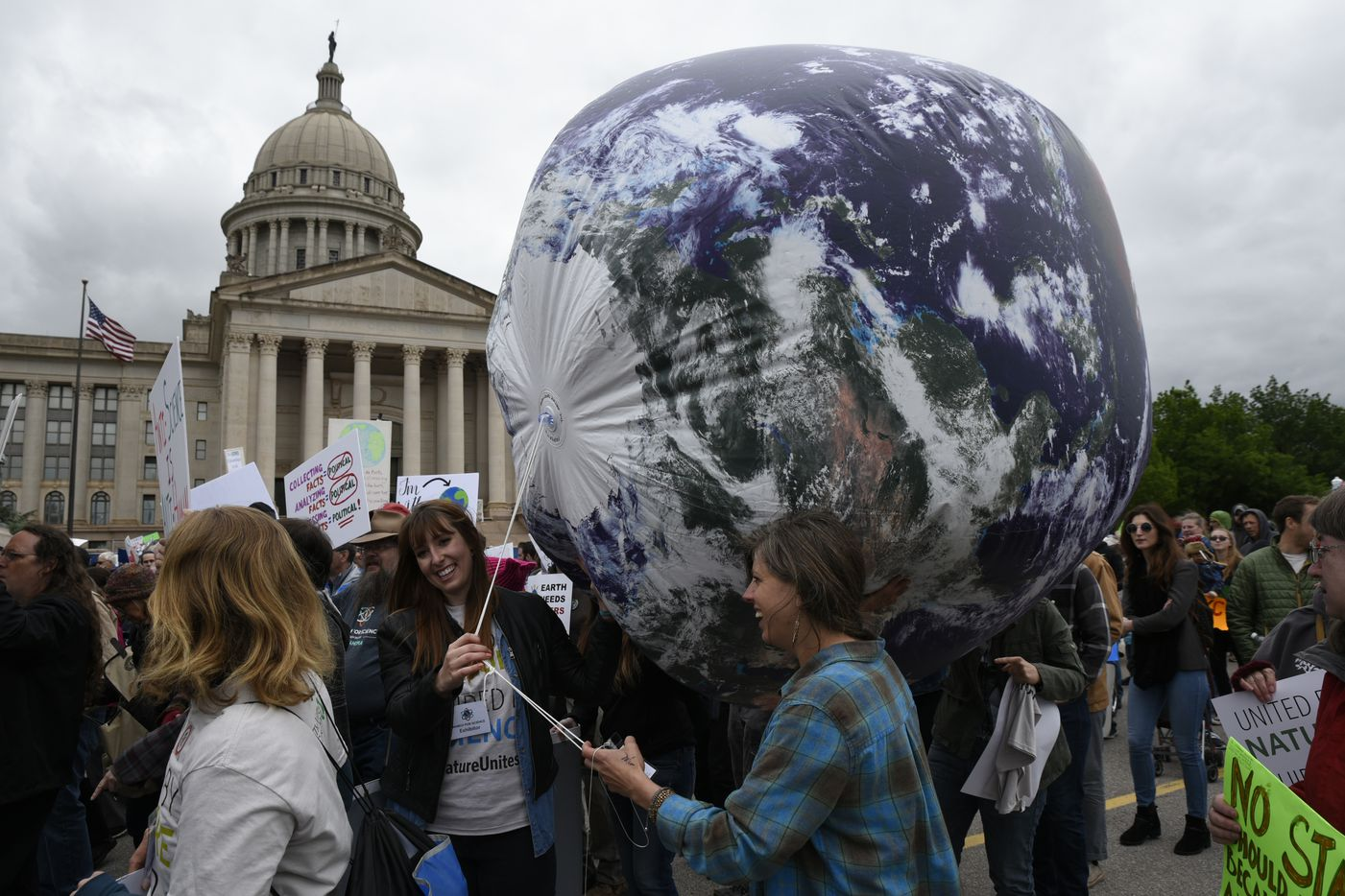 Members of the Oklahoma Nature Conservancy carry an inflatable globe during the March For Science at the Oklahoma State Capitol in Oklahoma City, April 22, 2017. Thousands of scientists and science advocates demonstrated in Washington and in smaller events around the world to support, defend and celebrate the scientific enterprise.  (Nick Oxford/The New York Times)