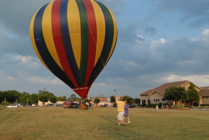 Scott Rohn trying to keep balloon straight