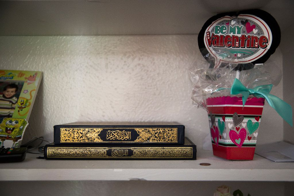 The Jawish family Quran, brought from their home Syria, rests on a shelf next to a Valentine's day gift at their apartment.