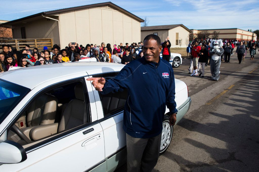Coach Kevin MaBone is surprised with a car during a presentation by students and teachers on Friday, January 20, 2017 outside Wilkinson Middle School in Mesquite, Texas. MaBone was diagnose with cancer, and had to rely on teachers to get to and from work and to cancer treatments. The school raised money to buy a car and gift it to MaBone. (Ashley Landis/The Dallas Morning News)