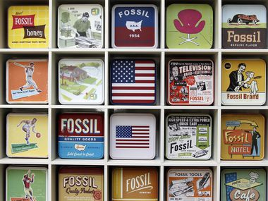 Richardson-based Fossil Inc. watch cases are on display in the main lobby of its headquarters.