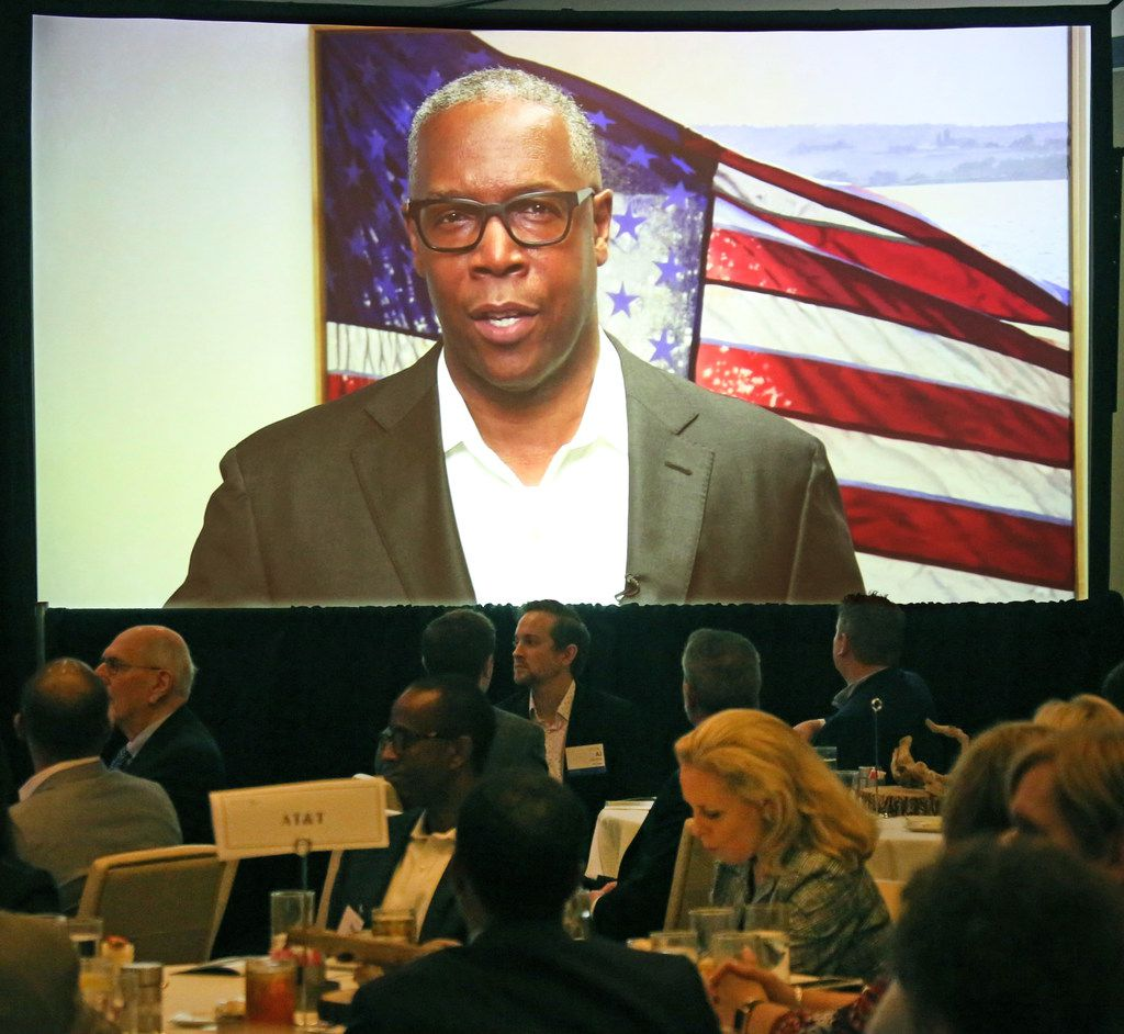 A video showing AT&T Chief Compliance Officer David Huntley talking about receiving an ethics award is played at the 2018 Greater Dallas Business Ethics Award luncheon. Huntley said his company is on the right track ethically but that was called into question a few hours later when AT&T's payments to President Trump's personal lawyer were revealed.