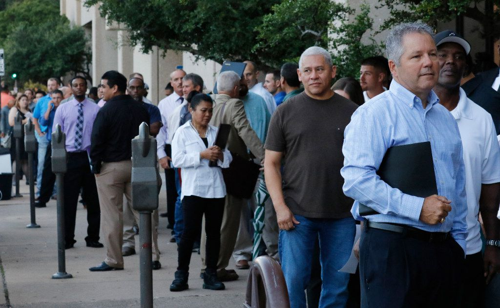 Tim Lashombe (right) of Haslet waits in a long line to apply for manufacturing positions for the F-35 fighter jet assembly plant at Lockheed Martin job fair at the Sheraton Hotel in downtown Fort Worth on Tuesday, Aug. 29, 2017.