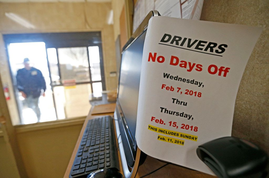 A note for drivers is attached to a computer monitor at McShan Florist in Dallas.