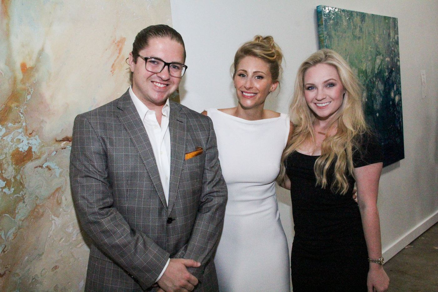 Jarrod Fresquez, Toni Martin and Megan Michelle at Random Art Gallery. The exhibit, Euphoria by Toni Martin, is a burst of color on the white walls.