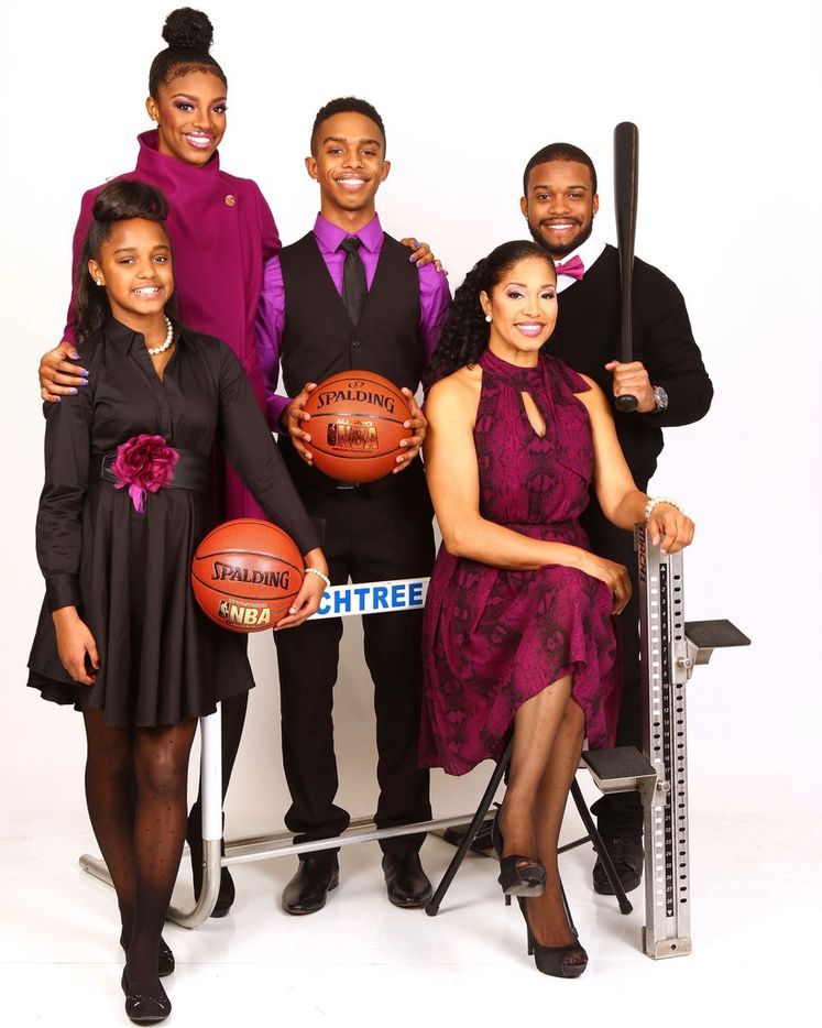 Pictured is Texas Rangers centerfielder Delino DeShields Jr. and his siblings and mother: From left to right: Siblings Denim, Diamond, D'Angelo, Delino and Tisha, their mother.  Diamond, D Angelo and Denim and mother, Tisha. Photo by Brian Christian Photography/Courtesy of Tisha DeShields.