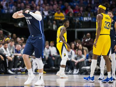 Dallas Mavericks guard Luka Doncic (77) puts his head in his shirt in response to a play during the first quarter of an NBA game between the Indiana Pacers and the Dallas Mavericks on Sunday, March 8, 2020 at American Airlines Center in Dallas.
