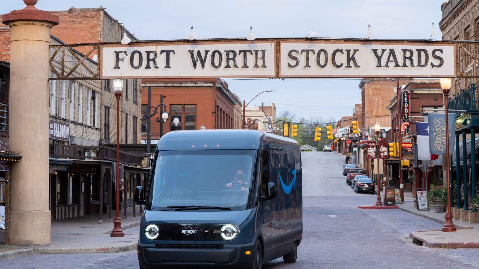 Designed and built in partnership with Rivian, Amazon s first custom electric delivery vehicle was unveiled last fall. Here it is at the Fort Worth Stockyards.