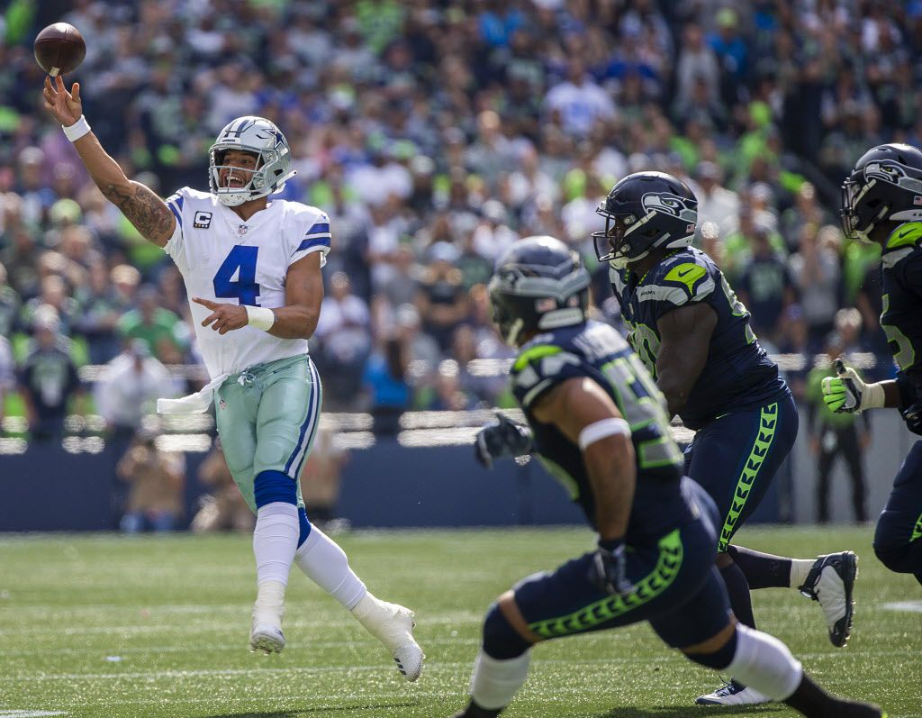 Dallas Cowboys quarterback Dak Prescott (4) throws a pass during the first half of an NFL football game against the Seattle Seahawks at CenturyLink Field on Sunday, Sept. 23, 2018, in Seattle.