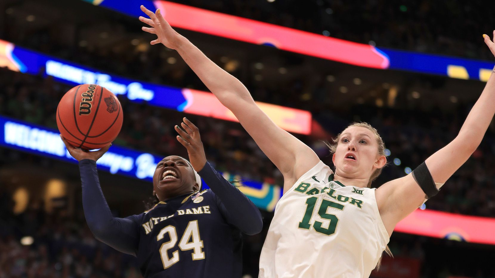 FILE - Notre Dame guard Arike Ogunbowale (left) attempts a shot against Baylor forward Lauren Cox during the first quarter in the championship game of the 2019 Women's Final Four at Amalie Arena on April 7, 2019, in Tampa, Fla.
