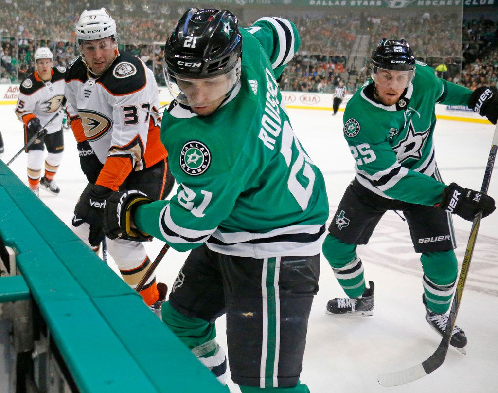 Dallas Stars Antoine Roussel (21) and Brett Ritchie (25) fight for the puck along the boards with Anaheim Ducks left wing Nick Ritchie (37) during the Anaheim Ducks vs. the Dallas Stars NHL hockey game at the American Airlines Center in Dallas on Friday, March 9, 2018. (Louis DeLuca/The Dallas Morning News)