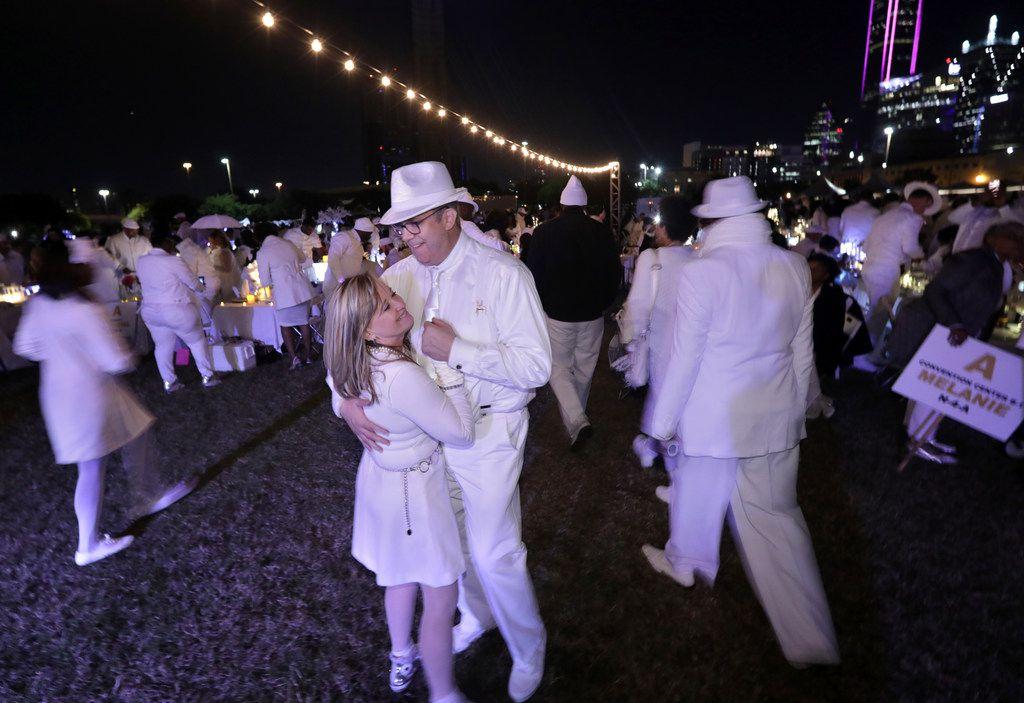 Gay Belt and Kevin Travell dance during a secret Diner en Blanc event at Reunion Park in Dallas on Nov. 9, 2018.