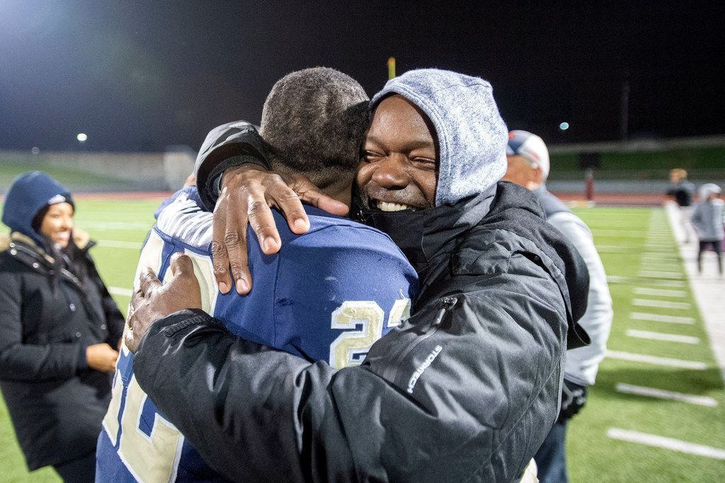 Jesuit senior running back E.J. Smith (22) gets a congratulatory hug from his father, NFL Hall of Famer and former Dallas Cowboys running back Emmitt Smith after accounting for all of his team's points in his team's victory over defending state champions Longview in an area round high school football playoff game on Friday, November 22, 2019 at John Kincaide Stadium Dallas. (Jeffrey McWhorter/Special Contributor)