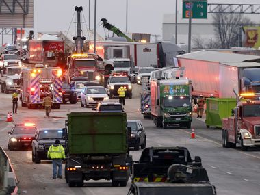 Cleanup continues on Interstate 35W near Northside Drive in Fort Worth after a 133-car pile-up early Thursday morning, Feb. 11, 2021. Six people died and 65 others were treated at area hospitals following the wreck in the southbound TEXPress lanes. A light coating of ice covered the stretch of highway leading to the chain reaction accident.