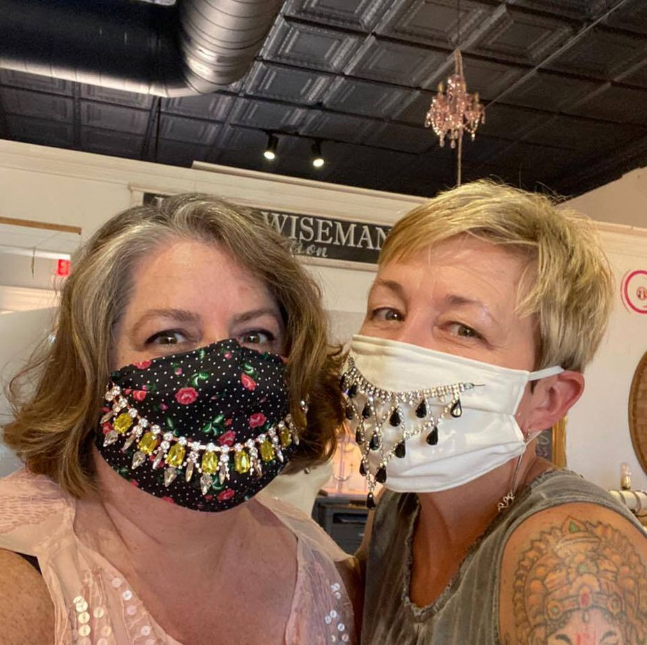 Karin Wiseman (left) and Trayc Claybrook (right) operate their respective stores in addition to an art center, called the Art Lounge, in the same retail building in downtown Garland.