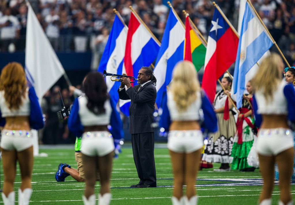 """Trumpet player Freddie Jones, shown playing the national anthem at Sunday's Cowboys-Rams game, says, """"I'm just trying to play it as best I can every time."""""""