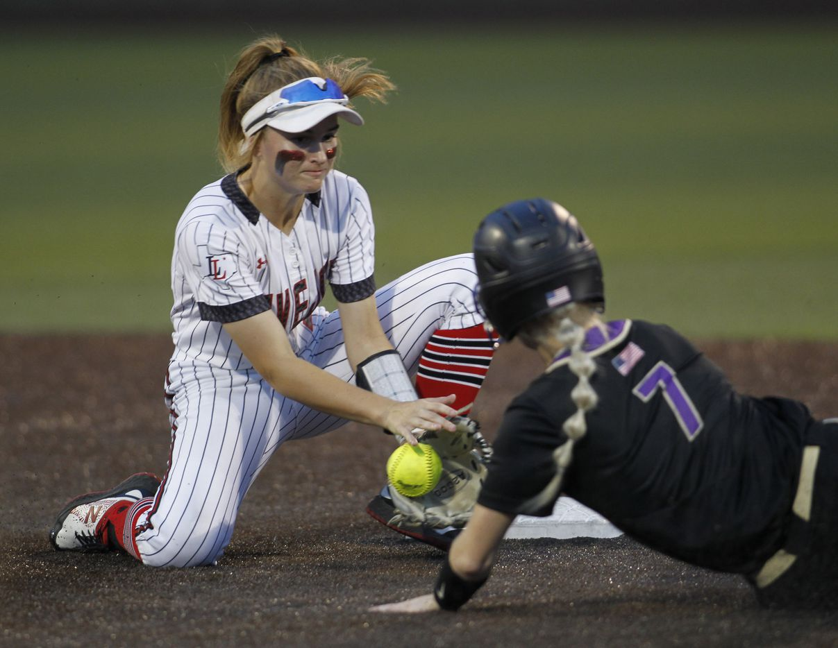 Lovejoy shortstop Skylar Rucker (5) secures the ball before making the tag at 2nd base as Hallsville baserunner Kammie Walker (7) is tagged out attempting a steal during the top of the 3rd inning of play. Game 2 of a best-of-3 Class 5A Region ll final series softball playoff game was  held at Rockwall High School in Rockwall on May 27, 2021. (Steve Hamm/ Special Contributor)