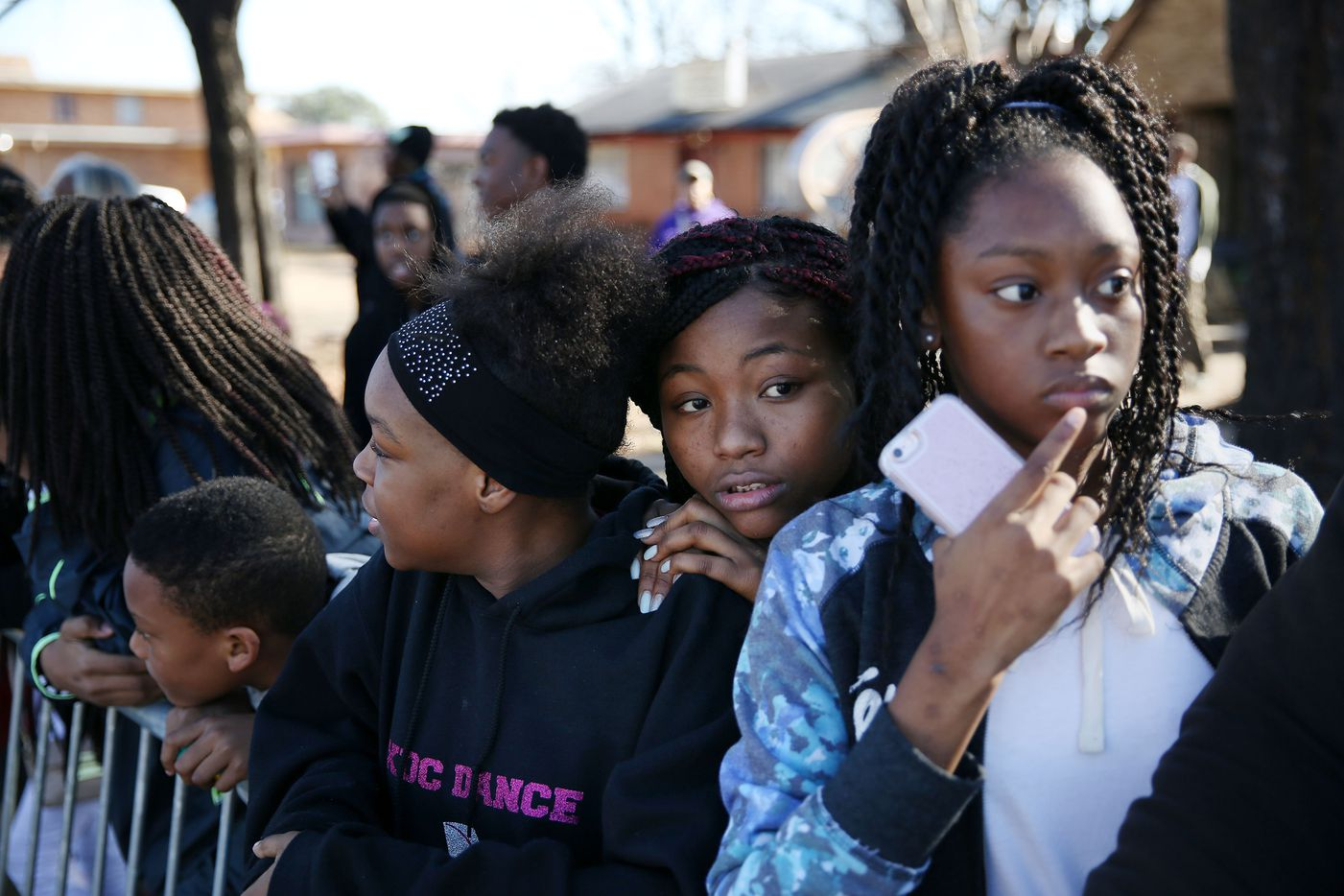 (From left) Angel Hardmon, 14, Samira Ahmed, 13, and Ashiree Walker, 13, watch the 35th Annual Dr. Martin Luther King, Jr. Birthday Celebration parade.