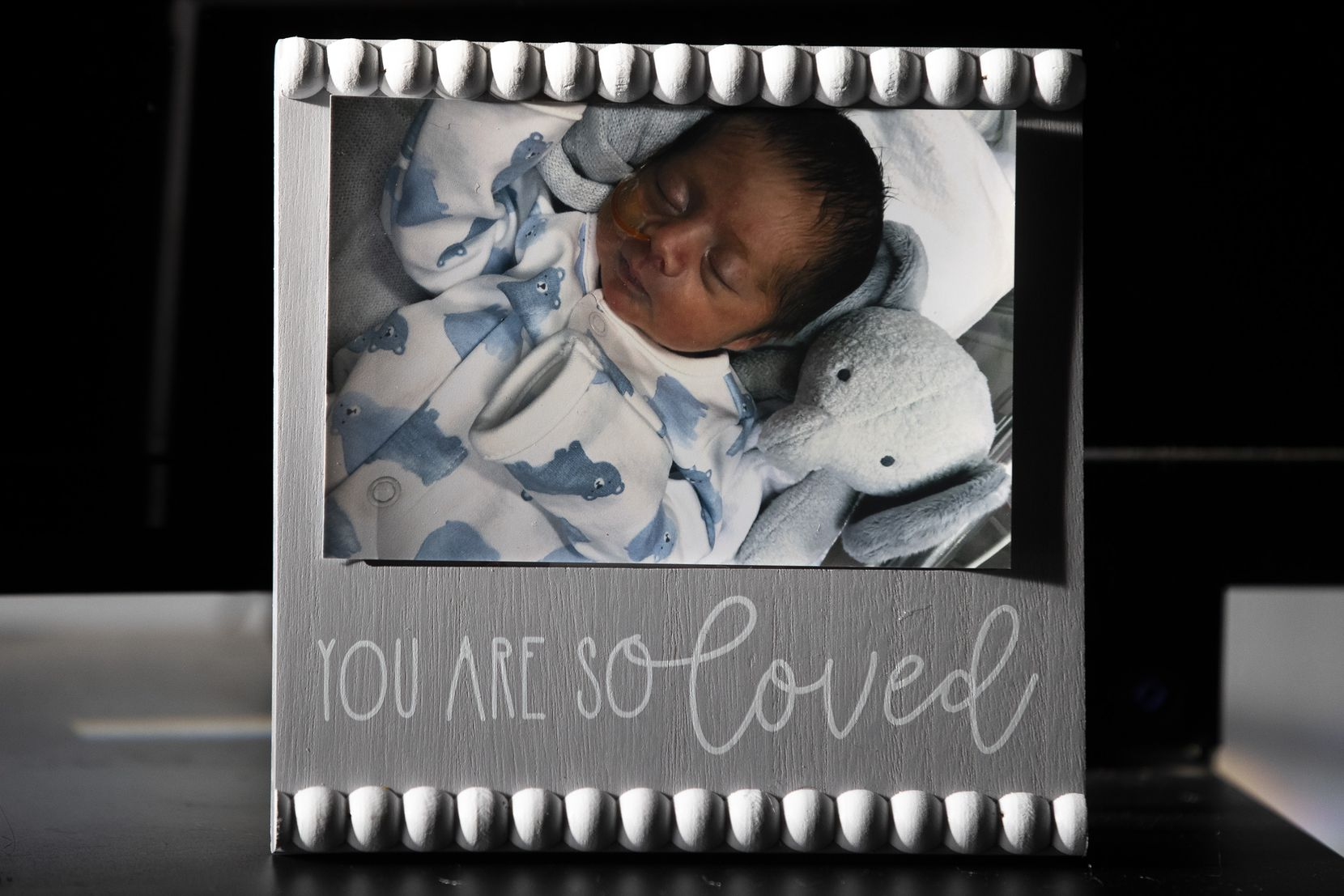 The Palacios family placed this photo of Isaiah in Nely's hospital room in January in hopes that it would be the first thing she saw when she recovered sufficiently to come off the ventilator that was providing mechanical support for her badly damaged lungs.