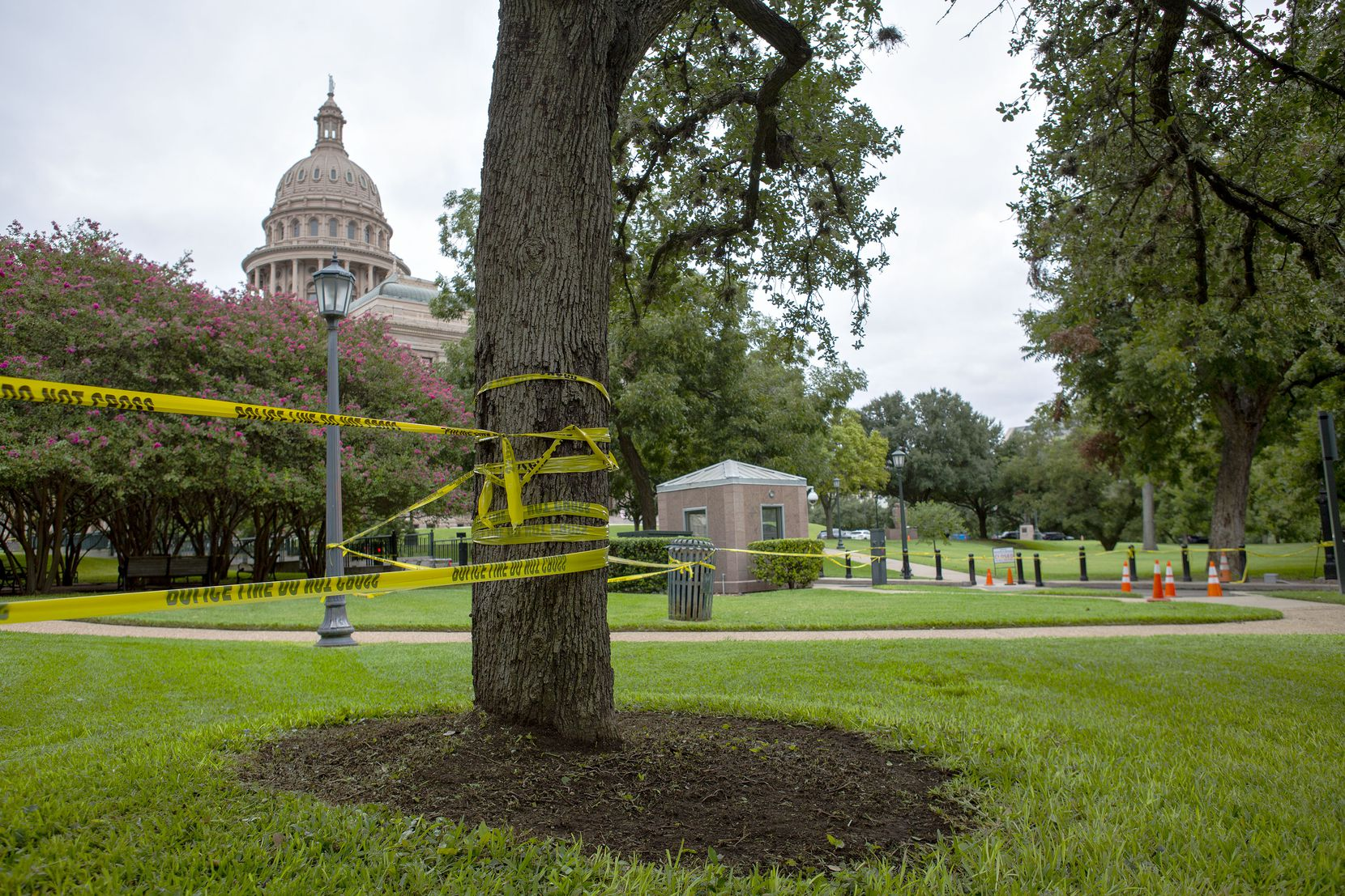 For many weeks, the grounds and buildings at the Texas Capitol Complex have been closed to all but a skeleton staff of workers. Police tape, chained gates and temporary barriers sealed off the grounds Thursday  — 110 days before the start of the Legislature's 87th regular session on Jan. 12, 2021.
