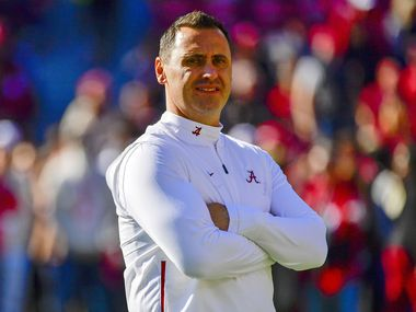In this Nov. 9, 2019, file photo, Alabama offensive Coordinator Steve Sarkisian watches warm-ups before an NCAA football game against LSU in Tuscaloosa, Ala.