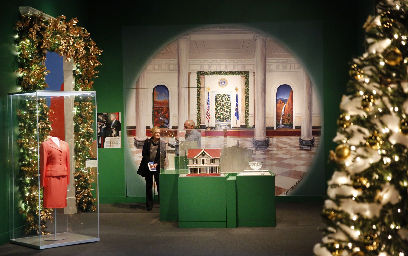 Visitors peruse the Holiday in the National Parks exhibit at the George W. Bush Presidential Center in University Park on Monday.