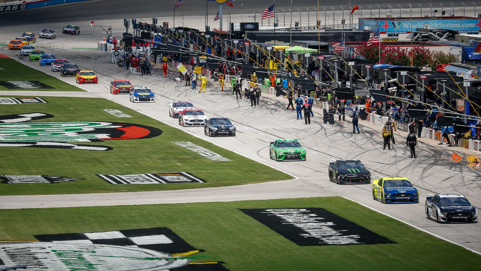 Drivers line up before the start of the NASCAR Cup Series O'Reilly Auto Parts 500 race on July 19, 2020 at Texas Motor Speedway in Fort Worth.