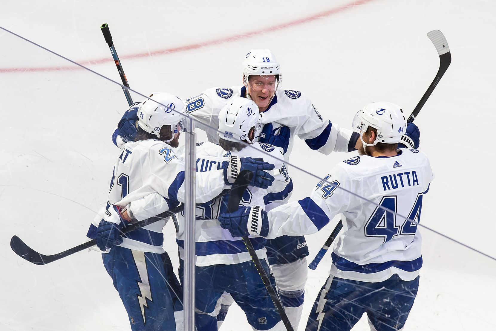 Brayden Point (21), Nikita Kucherov (86), Ondrej Palat (18), and Jan Rutta (44) of the Tampa Bay Lightning celebrate Kucherov's goal against the Dallas Stars during Game Three of the Stanley Cup Final at Rogers Place in Edmonton, Alberta, Canada on Wednesday, September 23, 2020. (Codie McLachlan/Special Contributor)