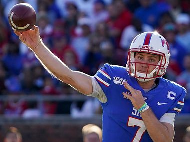 SMU quarterback Shane Buechele (7) throws a pass during the first half of an NCAA football game against Tulane at Ford Stadium on Saturday, Nov. 30, 2019, in Dallas.