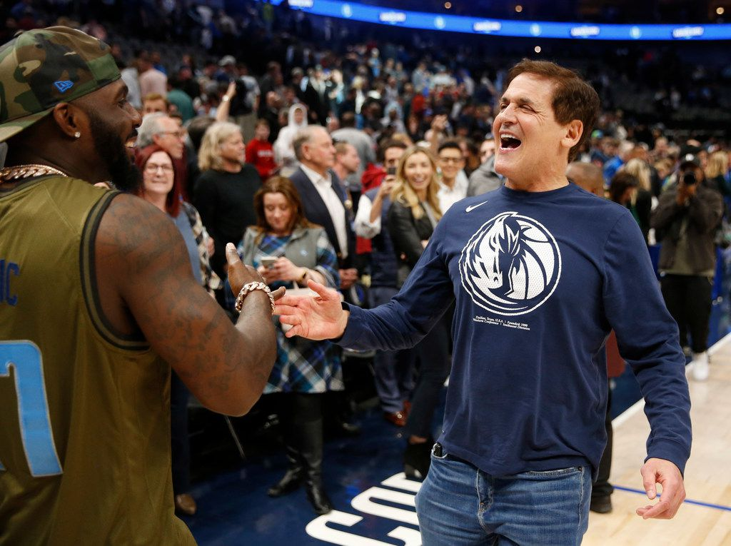 Dallas Mavericks owner Mark Cuban greets former Dallas Cowboys player Dez Bryant after the Dallas Mavericks defeated the New Orleans Pelicans in overtime 127-123 at American Airlines Center in Dallas on Wednesday, March 4, 2020.