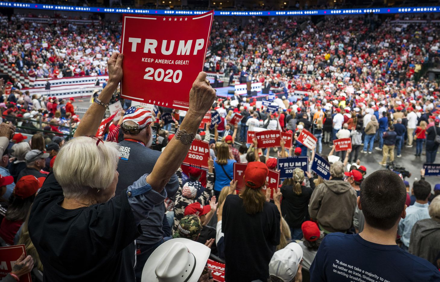 Supporters cheer President Donald Trump as he addresses a campaign rally at the American Airlines Center on Thursday, Oct. 17, 2019, in Dallas.