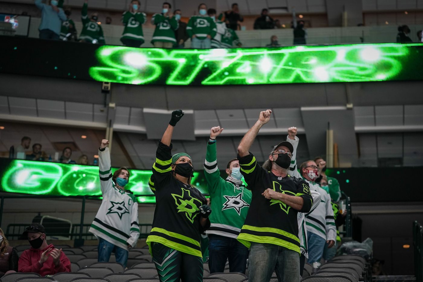Dallas Stars fans cheer after a power play goal to tie the game during the second period of an NHL hockey game against the Tampa Bay Lightning at the American Airlines Center on Thursday, March 25, 2021, in Dallas. (Smiley N. Pool/The Dallas Morning News)